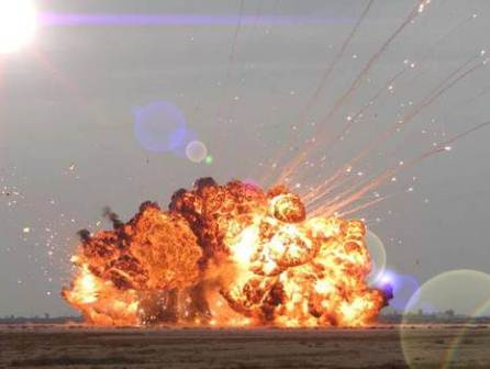BALAD AIR BASE, Iraq -- A controlled detonation eliminates unexploded ordnance found in the area.  Airmen of the 332nd Expeditionary Civil Engineer Squadron explosive ordnance disposal unit destroy items weekly.  (U.S. Air Force photo)
